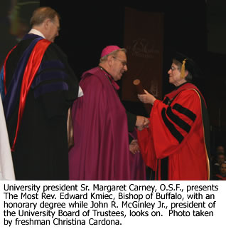 University president Sr. Margaret Carney, O.S.F., presents an honorary degree.
