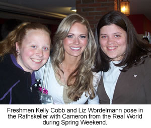 Freshmen Kelly Cobb and Liz Wordelmann pose in the Rathskeller with Cameron from the Real World during Spring Weekend