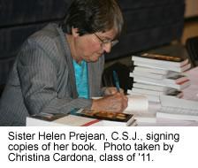 Sr. Prejean signing her book.
