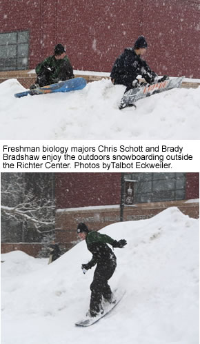 Students snowboarding outside the Richter Center.