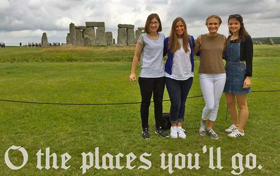 Four students standing in front of Stonehenge