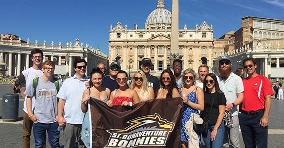 Perugia students holding a Bonnies banner outside the Vatican in Rome