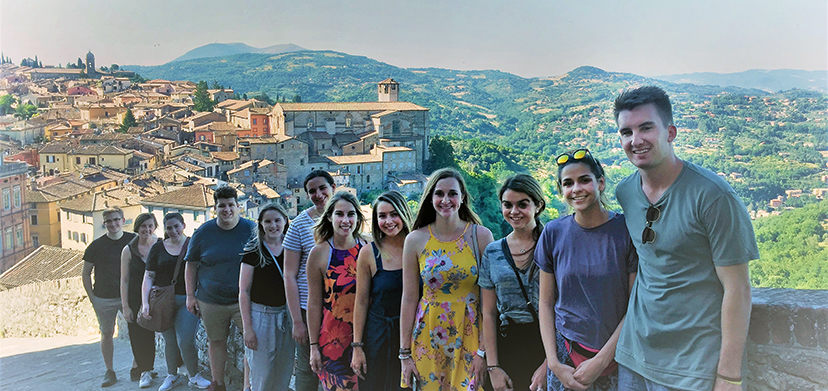 Summer study in Perugia students on a hillside overlooking the city.