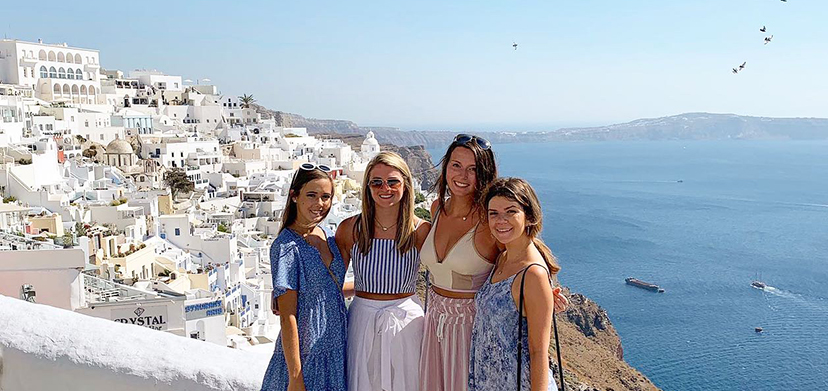 Four students on a coastal path overlooking Sorrento
