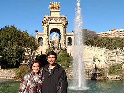 Two study abroad students by a fountain in Seville, Spain