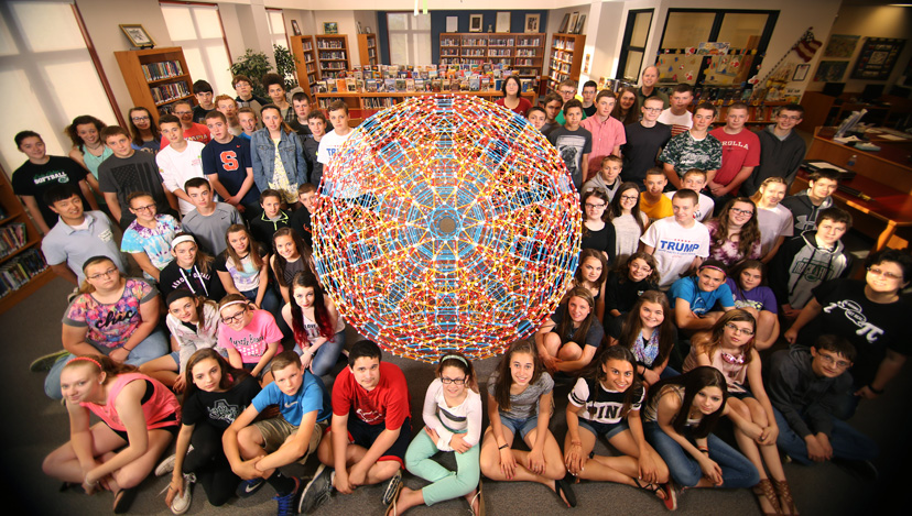 Linda Dodd-Nagel, her 8th-grade math students, Tae Cooke, and Chris Hill surround the runcitruncated hypericosahedron