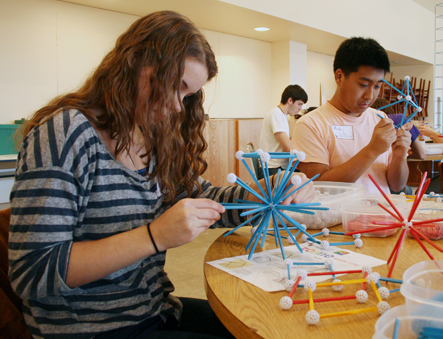 Nicole builds a truncated icosahedron while Andy constructs an elevated icosahedron.