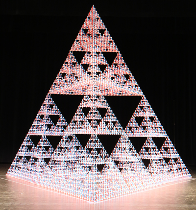 With theater spotlights illuminating the structure from above, the Sierpinski tetrahedron practically glows.