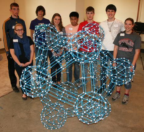 The students pose behind their completed project: a meta-icosahedron.