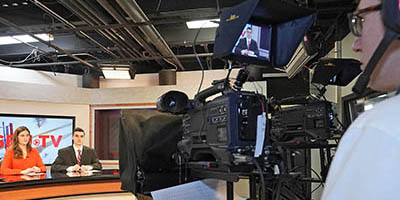 A student works the camera during an SBU-TV broadcast