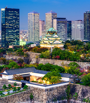 Osaka Castle, built in the 16th century, surrounded by modern skyscrapers.