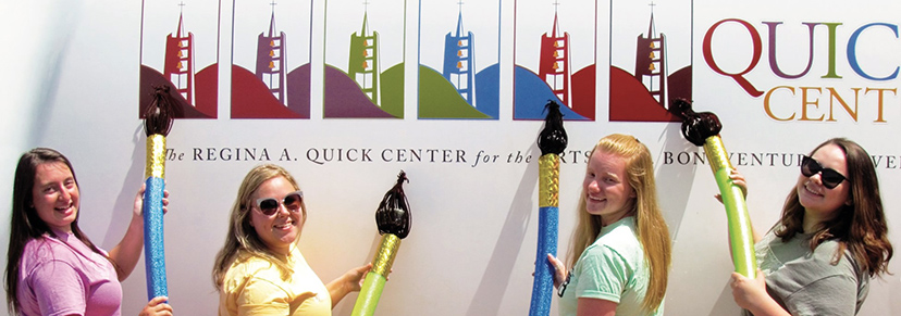 Students posing in front of the Quick Center's Artmobile